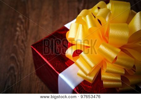 One Large Red Gift Box On A Wood