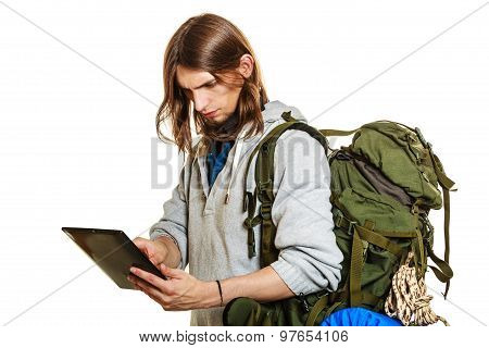 Backpacker Man Using Pc Tablet Browsing Internet.