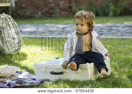 Baby Boy Sitting On Vintage Briefcase
