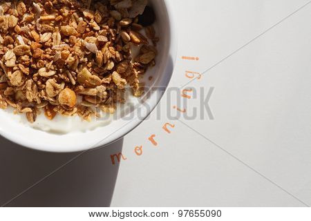The Word Morning Stamped Next To A Bowl Of Muesli And Yogurt With Hard Shadow To Convey Outdoors