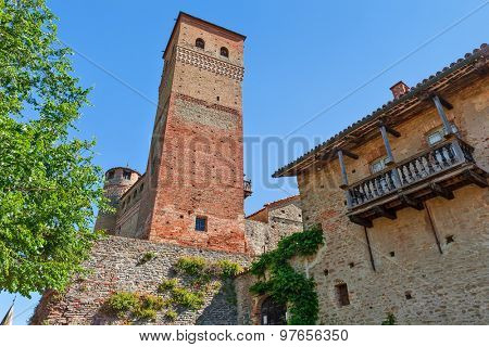 Old medieval tower under blue sky in Serralunga d'Alba in Piedmont, Northern Italy.