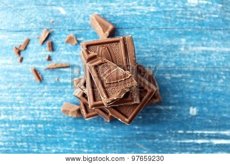 Chocolate Bars On Old Wooden Table Top View