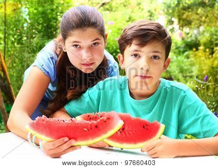 cute siblings couple with water melon slices