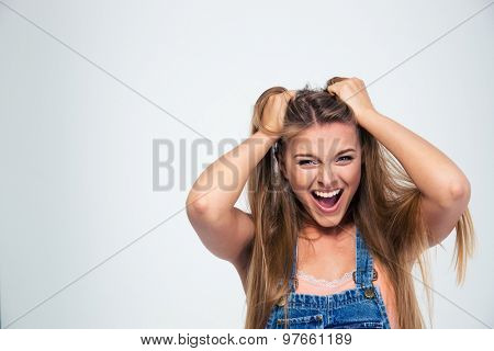 Portrait of a pretty young woman shouting isolated on a white background