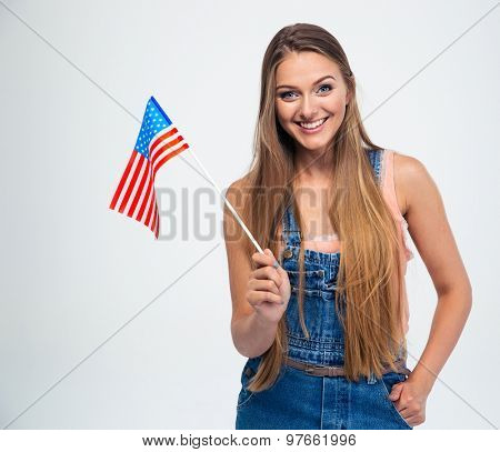 Smiling beautiful woman holding USA flag isolated on a white background. Looking at camera