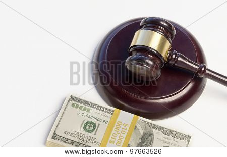 A Gavel,wood,block and pile of money isolated against white background