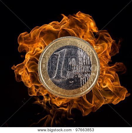 Euro coin with fire flames.