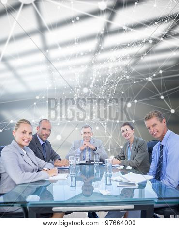 Business colleagues discussing about work against white room with windows at ceiling