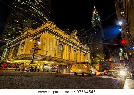 NEW YORK, NY, USA - MAR 17, 2014: Traffic outside Grand Central Terminal at night on 42nd Street in New York City