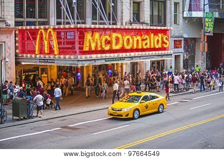 NEW YORK, NY, USA - June 12, 2015: The worlds biggest burger chain McDonald's restaurant on busy 42nd Street in New York City crowded with people