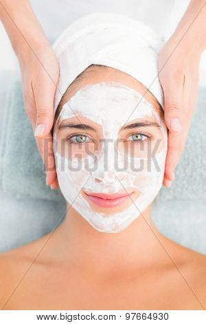 Portrait of an attractive young woman receiving treatment at spa center