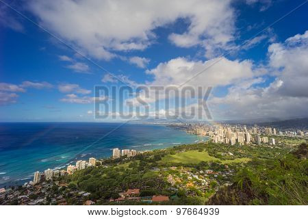 Hawaii rainbow and city skyline