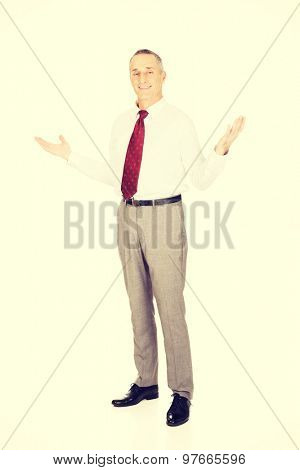 Full length businessman with hands open.