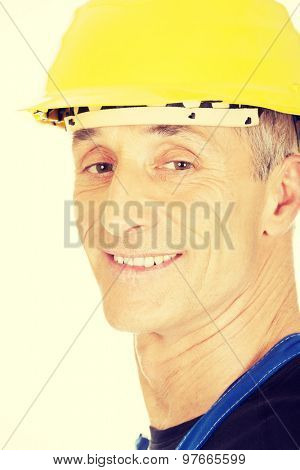 Smiling mature builder with a safety helmet.