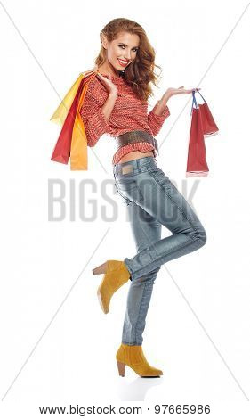 Attractive Young beautiful brunette Woman with Shopping Bags