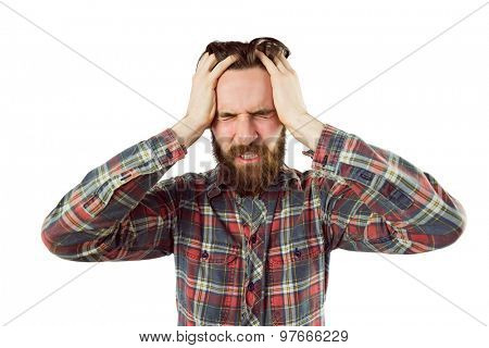 Handsome hipster getting a headache on white background