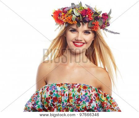 Slavic blonde girl in the flowers wreath