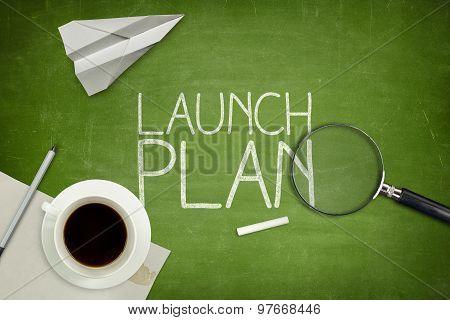 Launch plan concept on black blackboard