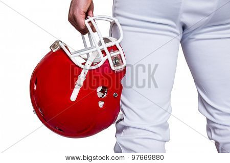 American football player holding a helmet on a white background