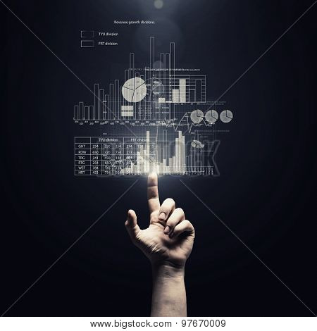 Human hand pointing with finger at market report chart