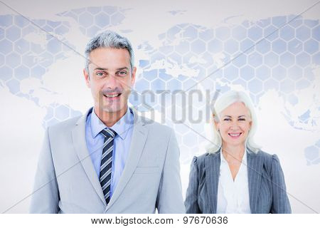 businessman and businesswoman smiling at the camera against background with world map businessman and businesswoman smiling at the camera on white background
