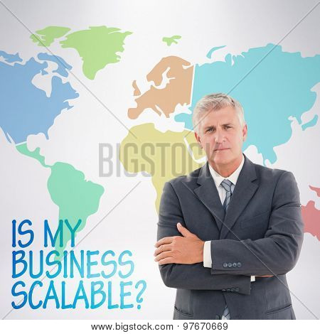 Serious businessman against grey background