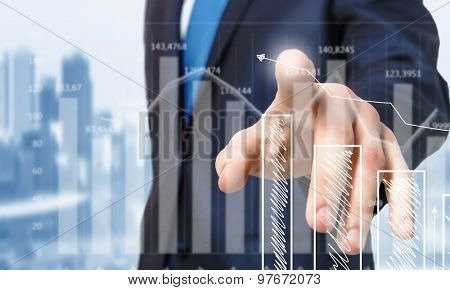 Close up of businessman touching increasing graph on media screen
