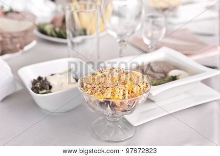 Salad With Seafood In A Salad Dish At The Dinner Table