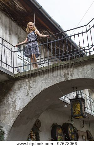 Beautiful young girl in the old courtyard of the Jewish quarter of Kazimierz in Krakow.