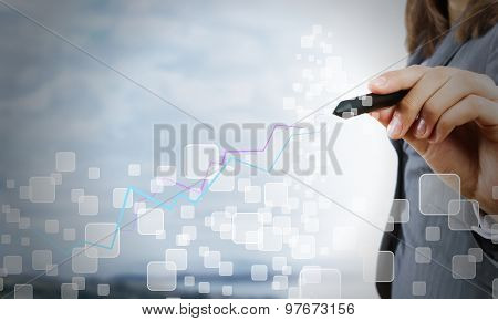 Chest view of businesswoman drawing with pencil increasing graph