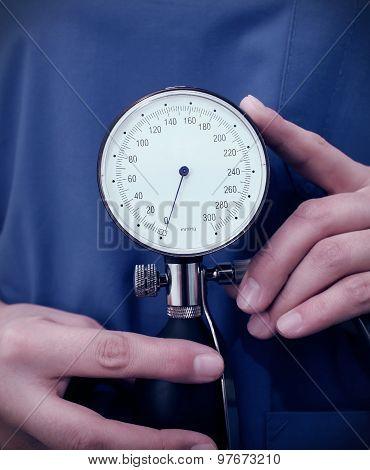 Pressure Gauge In The Hands Of A Doctor
