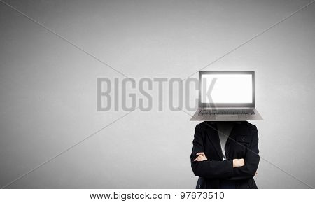 Businessman with laptop instead of his head