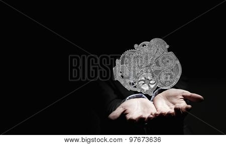 Close up of human hand holding gears engine