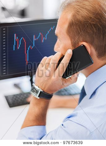 business, communication, money and technology concept- businessman with smartphone and forex chart on monitor screen in office