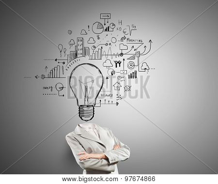 Idea concept with businesswoman and light bulb instead of her head