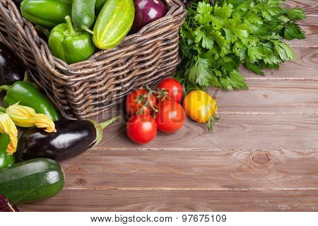 Fresh farmers garden vegetables and herbs on wooden table. View with copy space