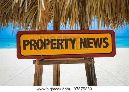 Property News sign with beach background