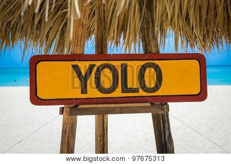 YOLO sign with beach background