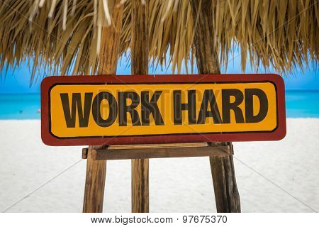 Work Hard sign with beach background