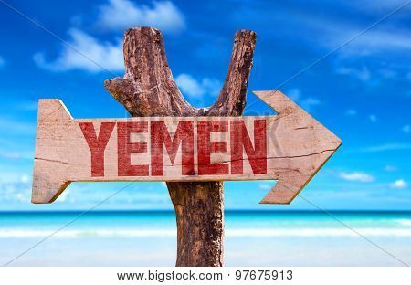 Yemen wooden sign with coast background
