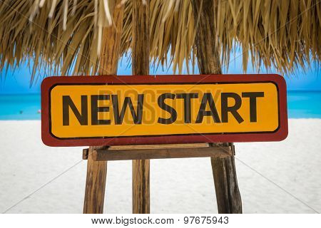 New Start sign with beach background