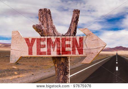 Yemen wooden sign with desert road background
