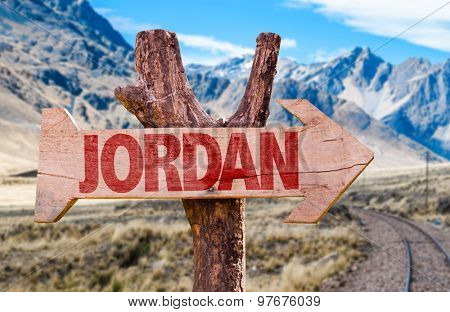Jordan wooden sign with desert road background