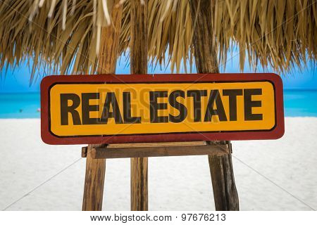 Real Estate sign with beach background