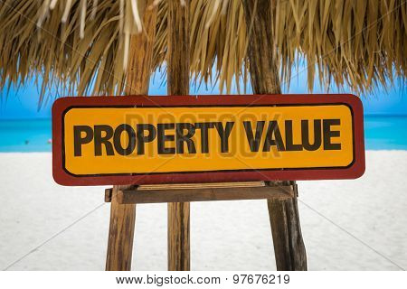 Property Value sign with beach background