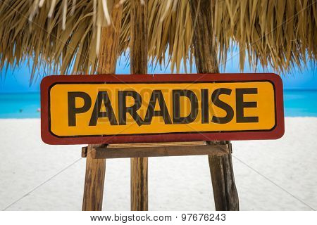 Paradise sign with beach background