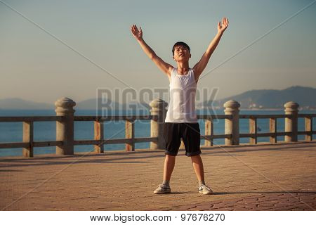 Vietnamese Boy Does Exercises On Embankment At Dawn