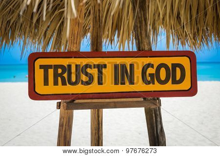 Trust in God sign with beach background