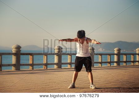 Vietnamese Boy Does Bending On Embankment At Dawn