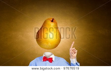 Headless businessman with pear instead of head